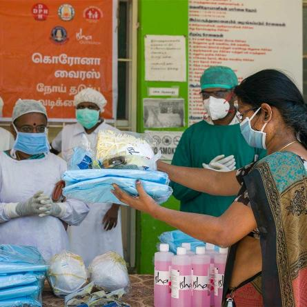 Isha is distributing medical kits such as Masks, sanitizer, Shoe covers, Protective goggles, etc. to health workers